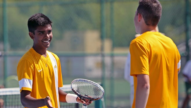 Sycamore's Nakul Narandan and partner Alex Taylor react after winning a game in doubles competition at the Southwest Ohio district championships at Centerville Saturday.