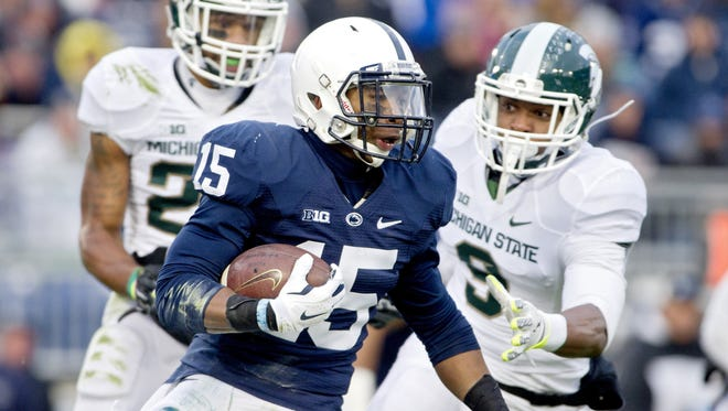 Penn State's Grant Haley (15) picks up yardage against Michigan State on Nov. 29, 2014.