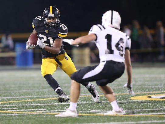 Southeast Polk Rams' Gavin Williams carries the football