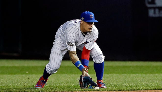 Javier Baez's latest act of infield creativity turned one out into two during Game 2 of the NLCS on Sunday.