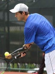 New Zealand's Alex Hunt prepares to serve the ball