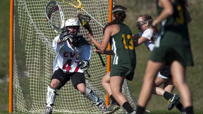 Bailee Pudvar (47) and Champlain Valley head to Mount Anthony for a Division I girls lacrosse playdown today.