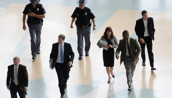 A security detail, upper left, accompanies Lt. Gov. Rebecca Kleefisch to a press conference in Green Bay in July 2011.