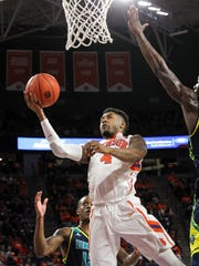 Clemson guard Shelton Mitchell (4) scores against UNCW during the first half on Wednesday at Littlejohn Coliseum in Clemson.