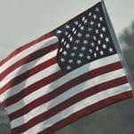 U.S. flag waves.