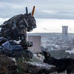 "Sharlto Copely as Chappie in Neill Blomkamp's ""Chappie."""