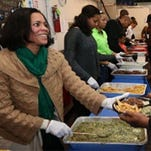 Ingrid Williams, wife of former New Orleans Pelicans coach Monty Williams, is shown feeding the hungry at a 2013 event. Ingrid Williams died Wednesday following a vehicle accident in Oklahoma City.