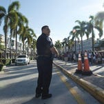 A Fort Pierce police officer helps with traffic control outside the Sunrise Theatre ahead of presidential nominee Hillary Clinton's visit Sept. 30 in Fort Pierce.