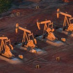 Pumpjacks are seen in an aerial view in the early morning hours of July 30, 2013, near Watford City, North Dakota. Fifty-seven percent of Iowans favor the proposed Bakken oil pipeline, which would cross 343 miles through Iowa while transporting North Dakota crude oil to Illinois, data from a Iowa Poll conducted last month shows.