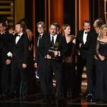 Show creator Vince Gilligan, center, with cast and crew accept Outstanding Drama Series for 'Breaking Bad' onstage at the 66th Annual Primetime Emmy Awards, Monday in Los Angeles, Calif.