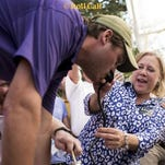 Sen. Mary Landrieu, D-La., helps with a keg stand before the Tigers' loss to Mississippi State on Saturday.