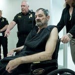 Frazier Glenn Cross, also known as Frazier Glenn Miller, appears at his arraignment in New Century, Kan., on April 15. Cross is being charged for shootings that left three people dead at two Jewish community sites in suburban Kansas City on April 13.
