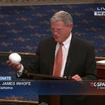 Sen. Jim Inhofe holds a snowball on the Senate floor Feb. 26.