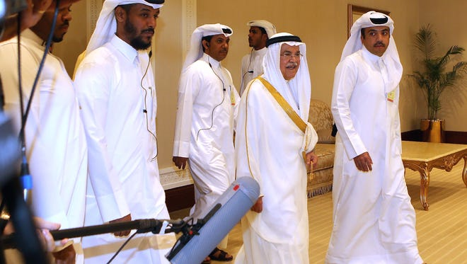Saudi Arabia's minister of Oil and Mineral Resources Ali al-Naimi, center, arrives Sunday for the organization of Petroleum Exporting Countries (OPEC) meeting, in the Qatari capital of Doha.