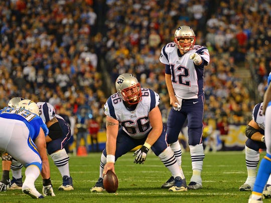 New England Patriots quarterback Tom Brady (12) gestures as center Bryan Stork (66) looks on during the first quarter against the San Diego Chargers at Qualcomm Stadium.