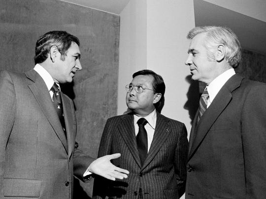 Tennessee Gov. Ray Blanton, left, U.S. Sen. Daniel K. Inouye and Metro Mayor Richard Fulton chat before the Hawaii Democrat Inouye addressed the first Governor's Conference on Tourist Development on Jan. 9, 1976, at the Hyatt Regency Hotel.