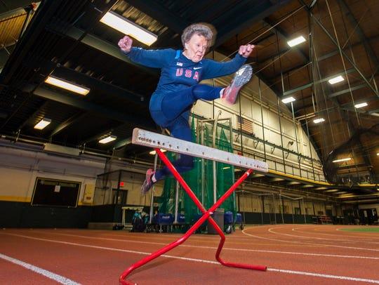 Flo Meiler, 82, of Shelburne, practices her hurdles