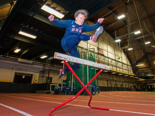 Flo Meiler, 82, of Shelburne, practices her hurdles as she works out at the University of Vermont in Burlington on Monday, November 14, 2016.