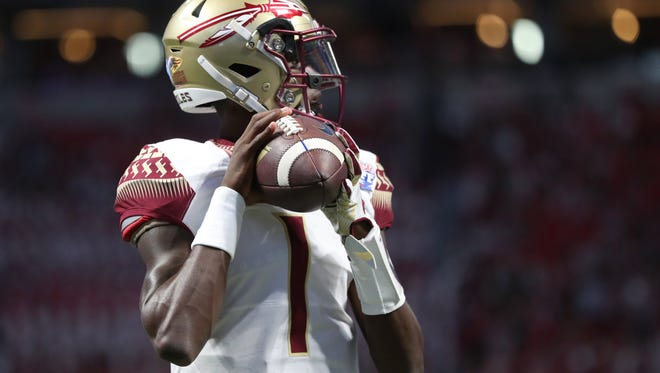 FSU's James Blackman warms up before their game against Alabama at the Mercedes-Benz Stadium in Atlanta on Saturday, Sept. 2, 2017.