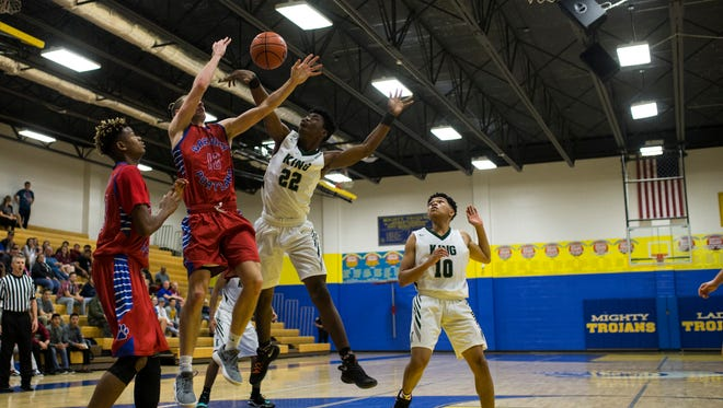 King's Chris Sayles blocks a shot from Gregory-Portland's B. Buerk during their District 30-5A Interzone playoff game Thursday, Feb.15, 2018 at Moody High School.