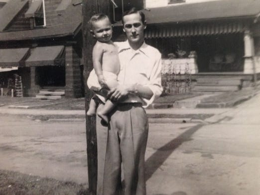 In this family photo, Eugene Flynt holds his young