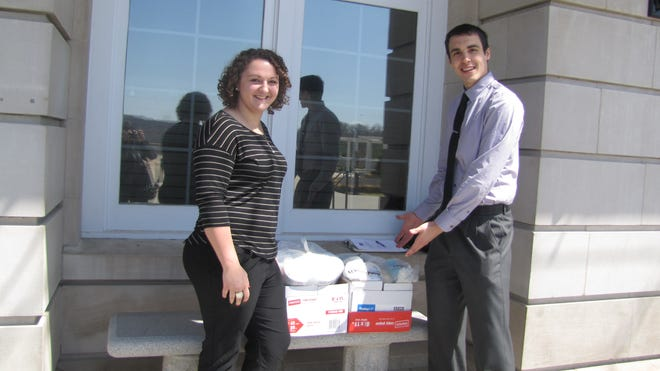 Melissa Gray, president of Eta Sigma Delta, the honors club at Culinary Institute of America, and Daniel Jerosz, club vice president, display some of the supplies they collected for the Greater Hudson Valley Family Health Center.