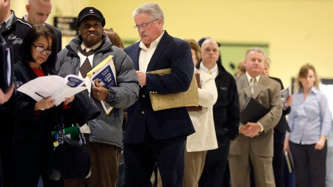 People wait in line at the Dr. King Career Fair at the Empire State Plaza Convention Center in Albany, N.Y., in April.