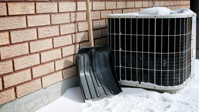You should cover your AC unit and prevent snow and debris from falling into the unit. A simple piece of plywood and brick to hold it down is the best.