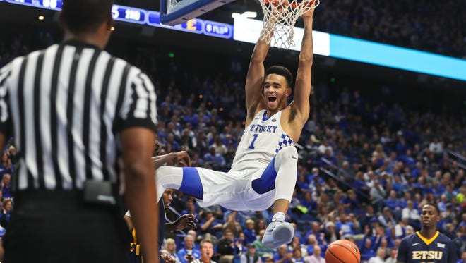 Kentucky's Sacha Killeya-Jones slammed down two points Friday night at Rupp Arena. The Wildcats won 78-61 after a sluggish start early in the first half. He finished with four.