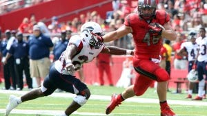 Rutgers senior Michael Burton pushes away a Howard defender on his way to a long gain. File photo by Mark R. Sullivan/Staff Photographer
