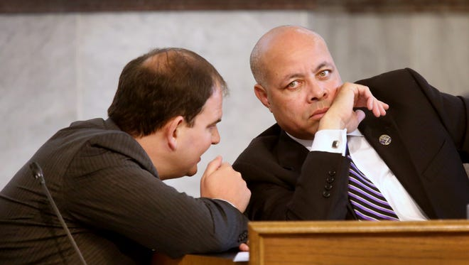 Cincinnati City Manager Harry Black, right, confers with Assistant City Manager John Juech during a council meeting.