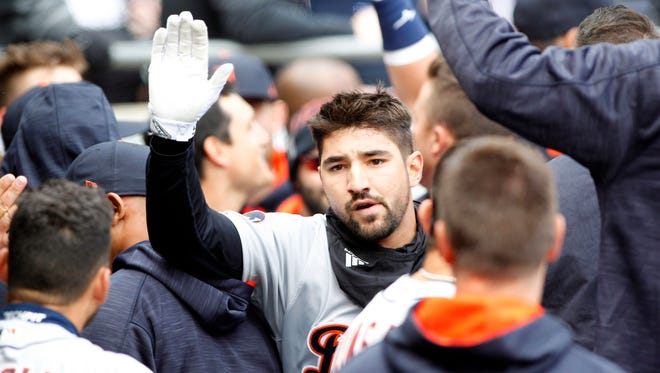 Apr 4, 2017; Chicago, IL, USA; Tigers third baseman Nick Castellanos celebrates with teammates after hitting a home run during the second inning against the White Sox.
