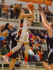 Ventura College sophomore Sienna Brown brings down a rebound in the Pirates' win over rival Moorpark College on Saturday night.