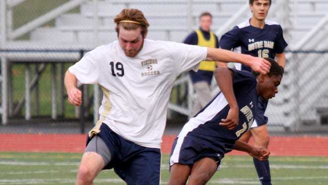 Matt D'Ortona, left, of Thousand Islands and Notre Dame's Rocco Coulibaly battle for possession on Saturday during a Class C boys soccer state quarterfinal at Chittenango High School.