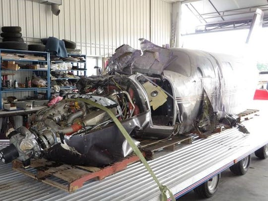 This photo shows damage to a Piper Malibu PA-46 that crashed at the Experimental Aircraft Association's AirVenture on Wednesday, July 22, 2015.