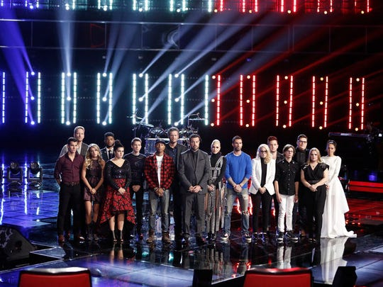 The Live Finals Top 12 show opened with the coaches, singers and host - (l-r) Zach Seabaugh, Barrett Baber, Mark Hood, Madi Davis, Kvan McKeel, Parrell Williams, Blake Shelton, Carson Daly, Gwen Stefani, Adam Levine, Lorin Bukowski, Jeffery Austin, Braiden Sunshine, Jordan Smith, Shelby Brown, Amy Vachal, offering a moment for the victims and families  of the terror attacks in Paris.