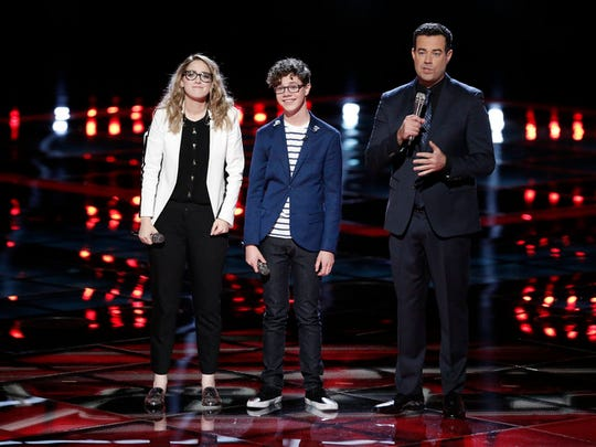 """The Voice"" Host Carson Daly stands with Korin Bukowski and Braiden Sunshine as they await the verdict of the Twitter Save for the Top 9."