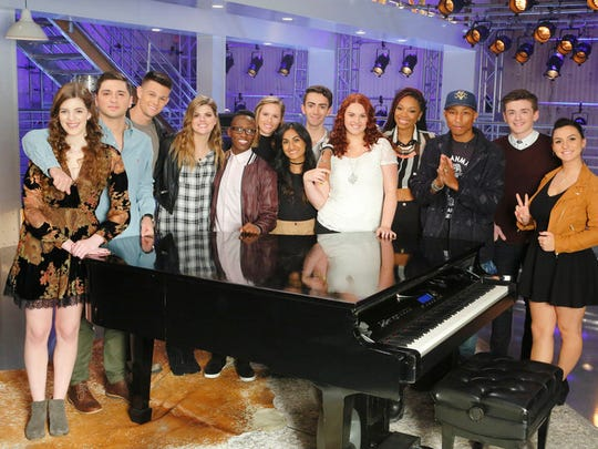 """Edison's Moushumi (center) drew high praise from the coaches in her Blind Audition on """"The Voice"""" and secured one of the last spots on Team Pharrell, (l-r) Emily Keener, Joe Vivona, Nick Hagelin, Caity Peters, Brian Nhira, Hannah Houston, Moushumi, Jonathan Bach, Jessica Crosbie, Maya Smith, Pharrell Williams, Jonathan Hutcherson, and Abby Celso."""