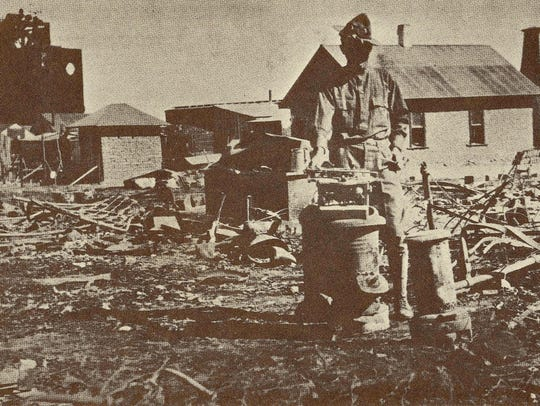 A soldier surveys the devastation in Columbus following