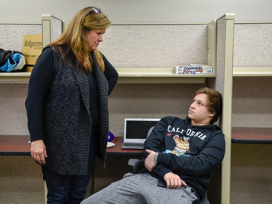 Rebecca Rosenblatt, director of the Ridgecrest Academy talks with a student between class and therapy, Thursday November 10, 2016 in Nashville, Tenn. Ridgecrest Academy is a recovery high school for teens with addictions to drugs and alcohol. (Photo: Lacy Atkins / The Tennessean)