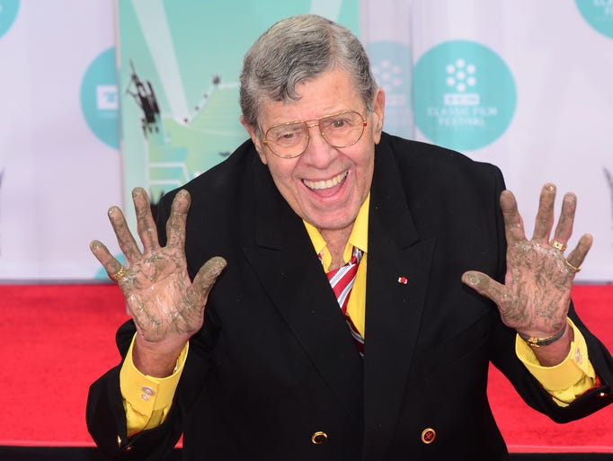 Jerry Lewis shows his hands at the honorary hand and footprint ceremony at the TCL Theater in Hollywood Saturday April 12, 2014. <br /> The event was part of the Turner Classic Movie Film Festival.