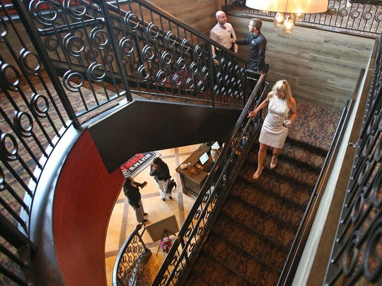 The stairway leading between the levels of the new Ruth's Chris Steak House.