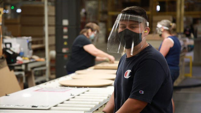 Headquartered in Holland, Haworth designs and manufactures adaptable workspaces. Per state requirements, all employees are currently required to wear masks.