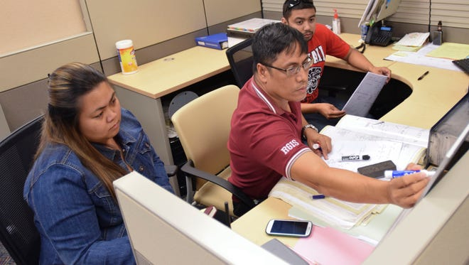 Intern Reina Duenas, left, sits in a training session as part of the Guam Power Authority summer internship program.