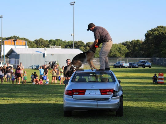 K-9 dog Havoc shows off his impressive skills during a demonstration at Hammonton's National Night Out.
