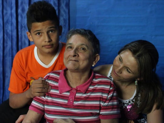 Maria Nelly is pictured here with her daughter, Janeth Milena, and her grandson. Janeth Milena is the primary caregiver for Maria Nelly.
