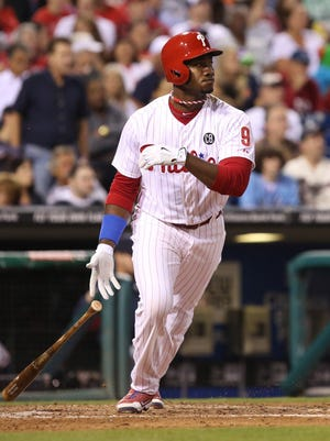 Philadelphia Phillies left fielder Domonic Brown (9) hits a single during the sixth inning Sept. 26 against the Atlanta Braves at Citizens Bank Park. The Phillies defeated the Braves 5-4. Credit: Bill Streicher-USA TODAY Sports