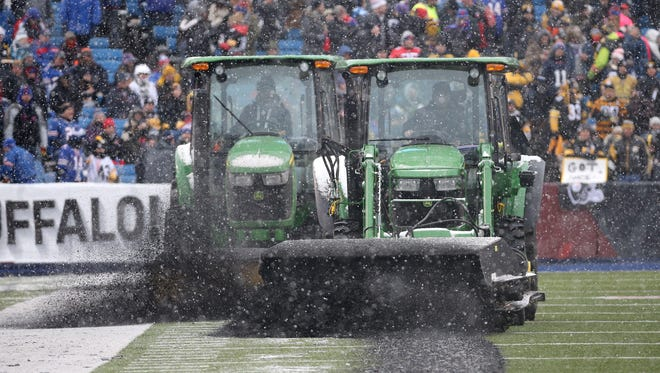 The start of the second half was delay when stadium officials had to clear turf pellets after the tractor brushes created piles in the end zones.