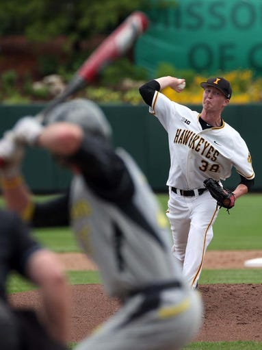 The Iowa Hawkeyes' Tyler Peyton pitches against the