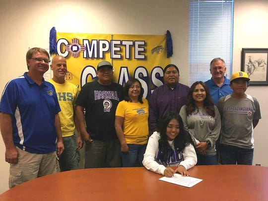 Bloomfield's Kara Watchman signs a letter of intent to play basketball for Haskell Indian Nations University.